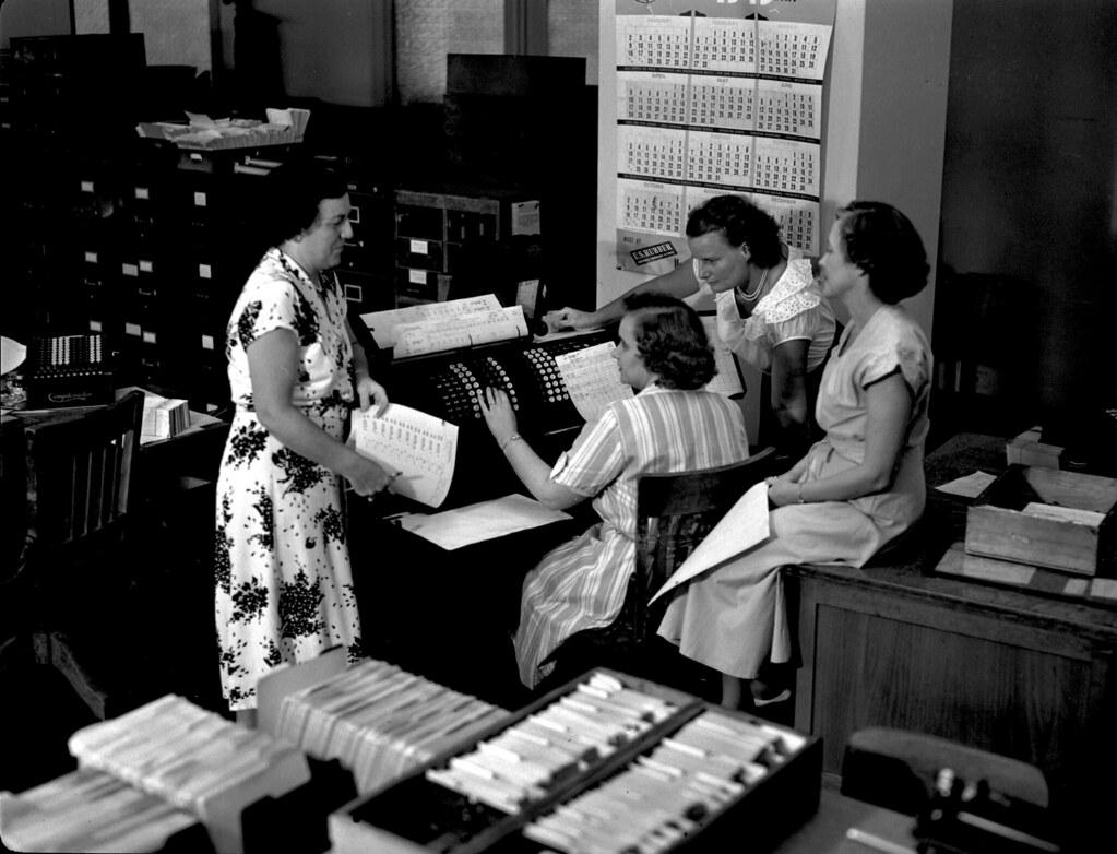 Pre-digital era photo of women working with data twenty-spot low credit business loans